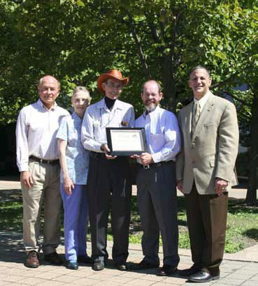 Detroit Audubon Society presents Chrysler Group with Safe Passage Great Lakes certificate of recognition. From left to right: Frank Zaski, Doris Applebaum, and Fred Charbonneau, Detroit Audubon Society; Greg Rose, Director–Environment, Health & Safety and Sustainability, Chrysler Group LLC; Glenn Hoffrichter, Senior Manager–Facilities Planning & Business Services, Chrysler Group LLC.